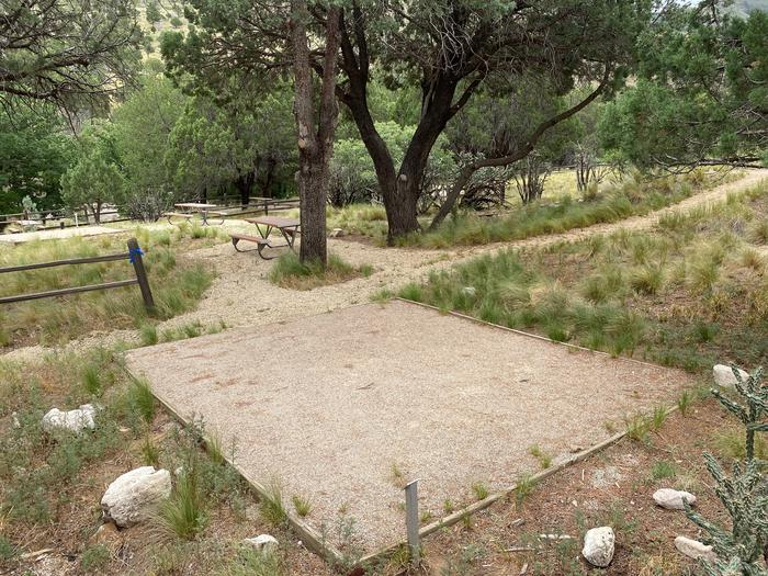 This view of tent site #9 show a path that separates the tent pad from the picnic table.  Campsite #8 is visible in the background.Tent campsite #9 has a low traffic footpath dividing the site.  The picnic table is just below the  trail.
