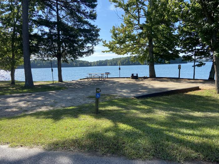 A photo of Site 42 of Loop SPRINGFIELD  at SPRINGFIELD with Picnic Table, Electricity Hookup, Fire Pit, Shade, Tent Pad, Waterfront, Lantern Pole, Water Hookup, Handicap Accessible