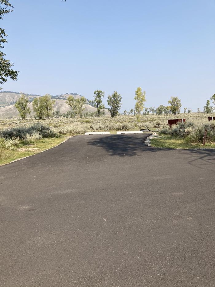 A photo of Site 3 of Loop EC at Gros Ventre Campground with Picnic Table, Fire Pit, Food Storage