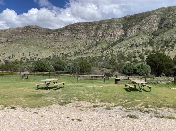 Campsite RV-A is shown with a picnic table a wood fence runs behind the site. This site has a natural grass surface Dog Canyon Campsite RV-A.