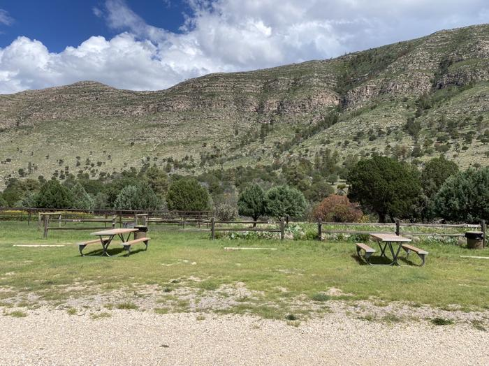 Campsite RV-B has a natural, level surface. A wood fence runs behind the site. A picnic table is available. Dog Canyon Campsite RV-B offers great views of Algeria ridge.
