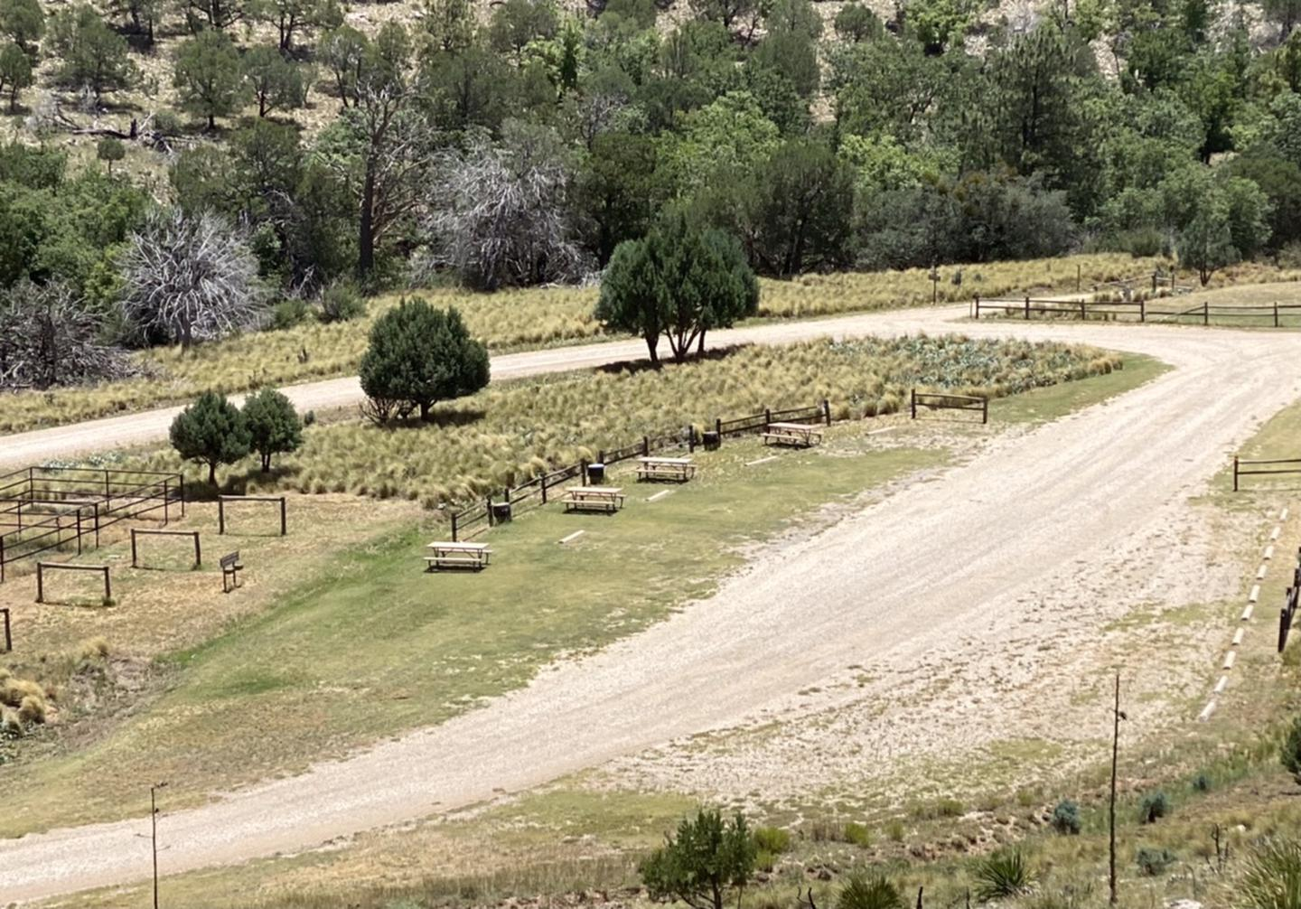 Dog Canyon RV campsite area. Four RV sites available and are located next to the trailhead and horse corals. Overview of the four Dog Canyon RV sites.  Trailhead parking is just across from the campsites.