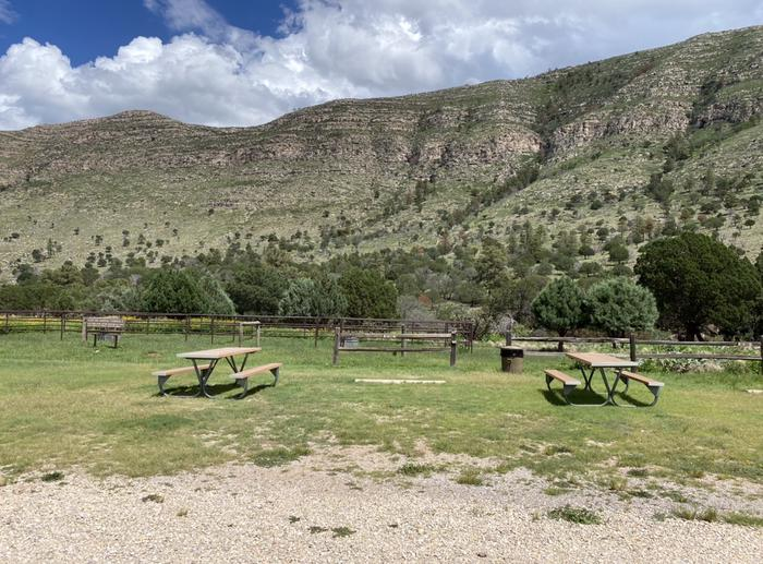 Dog Canyon RV campsite, mountains in the background and a picnic table for campersDog Canyon RV campsite, RV-A
