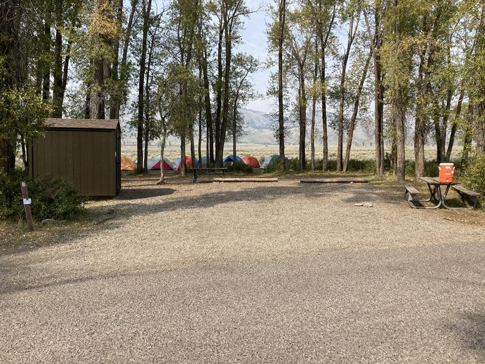 Site B GroupSite has several picnic tables, food storage building and several fire rings with cooking grate.