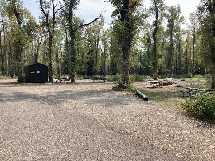 Site D GroupSite has several picnic tables, food storage building and several fire rings with cooking grate.