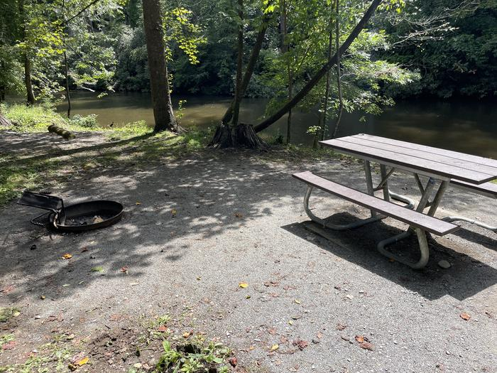 A photo of Site A07 of Loop A at ABRAM'S CREEK CAMPGROUND with Picnic Table, Fire Pit, Shade, Waterfront