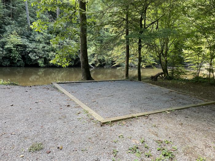 A photo of Site A03 of Loop A at ABRAM'S CREEK CAMPGROUND with Shade, Tent Pad, Waterfront