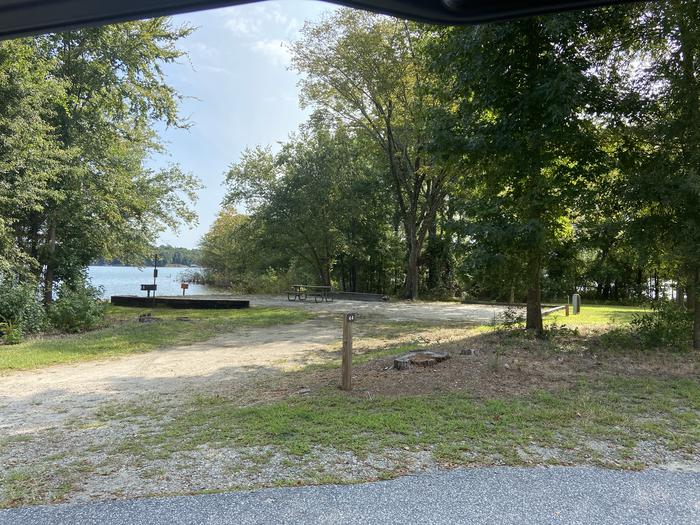 A photo of Site 44 of Loop SPRINGFIELD  at SPRINGFIELD with Picnic Table, Electricity Hookup, Fire Pit, Shade, Tent Pad, Waterfront, Lantern Pole, Water Hookup