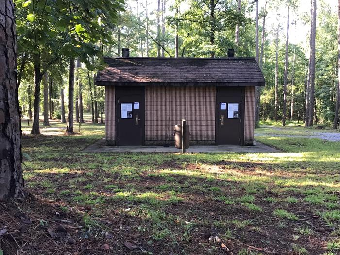 A photo of facility Collins Creek Seasonal Campground (SC) with No Amenities ShownA photo of bathroom facility at Collins Creek Campground (SC)