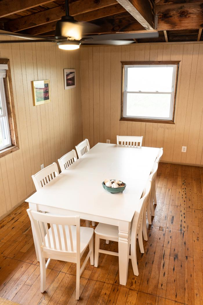 A dining table that seats 8.Dining room at the Bayberry Dunes House