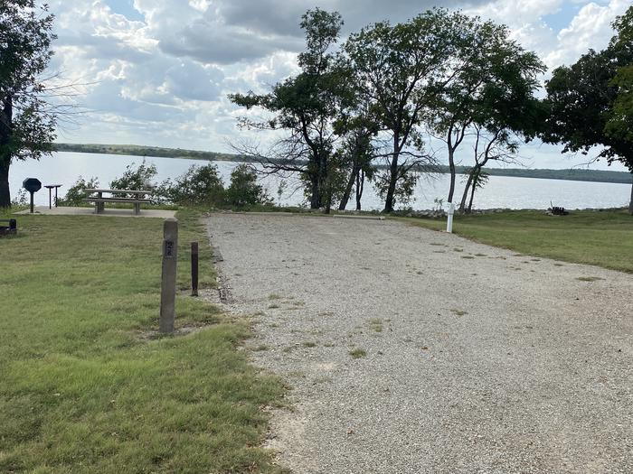 A photo of Site 028 of Loop WHITEHALL BAY  at WHITEHALL BAY with Picnic Table, Electricity Hookup, Shade, Waterfront