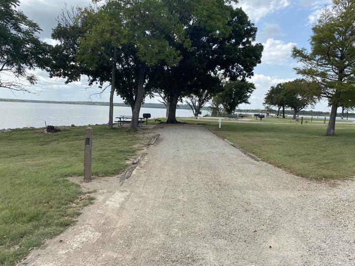 A photo of Site 027 of Loop WHITEHALL BAY  at WHITEHALL BAY with Electricity Hookup, Shade, Waterfront