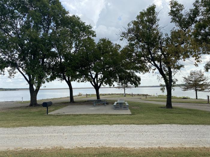 A photo of Site 029 of Loop WHITEHALL BAY  at WHITEHALL BAY with Picnic Table, Electricity Hookup, Shade, Waterfront