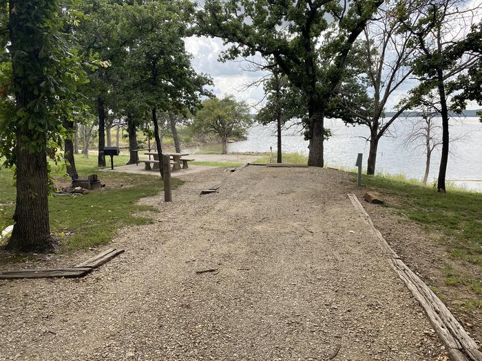 A photo of Site 005 of Loop WHITEHALL BAY  at WHITEHALL BAY with Picnic Table, Electricity Hookup, Shade