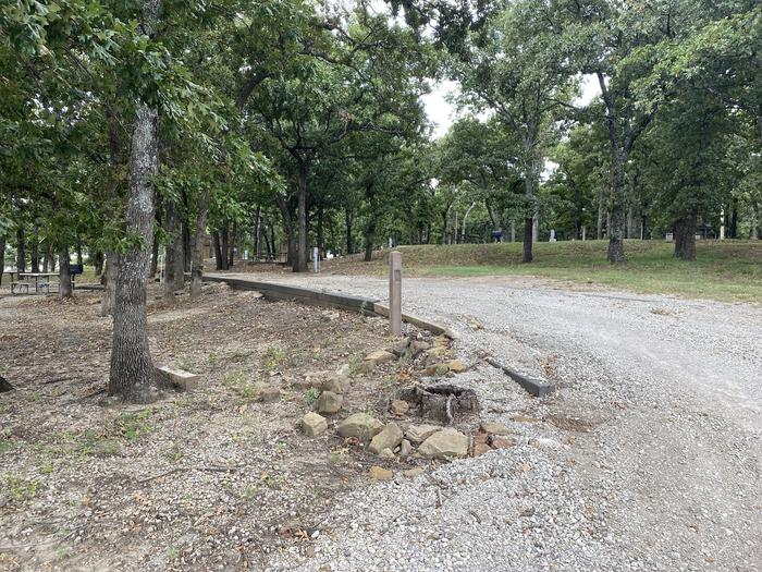 A photo of Site 016 of Loop WHITEHALL BAY  at WHITEHALL BAY with Picnic Table, Shade, Full Hookup