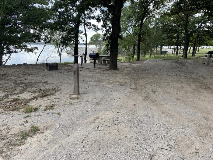 A photo of Site 013 of Loop WHITEHALL BAY  at WHITEHALL BAY with Picnic Table, Shade, Full Hookup