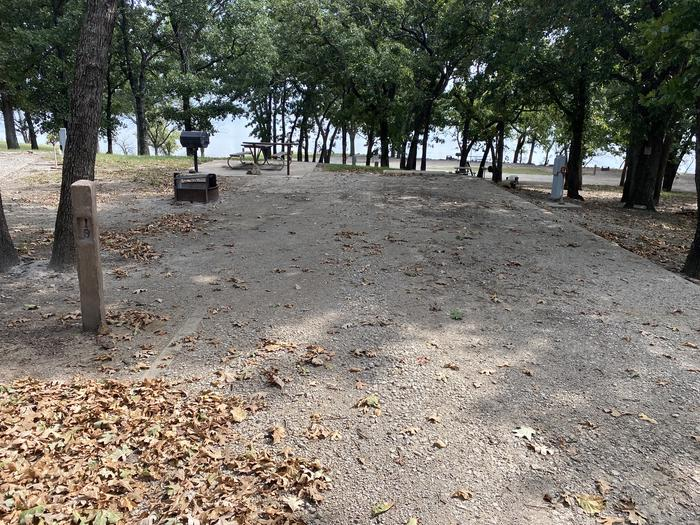 A photo of Site 019 of Loop WHITEHALL BAY  at WHITEHALL BAY with Picnic Table, Shade, Full Hookup