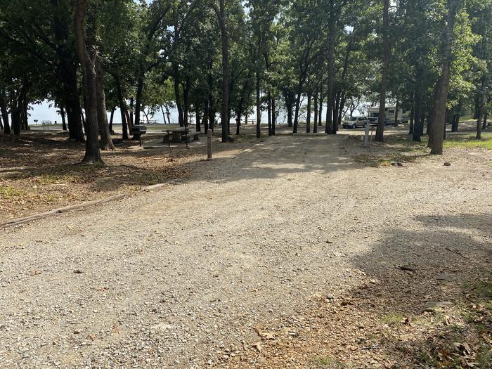 A photo of Site 020 of Loop WHITEHALL BAY  at WHITEHALL BAY with Picnic Table, Shade, Full Hookup