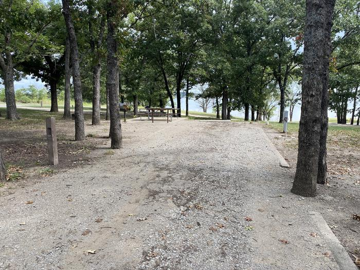 A photo of Site 018 of Loop WHITEHALL BAY  at WHITEHALL BAY with Picnic Table, Shade, Full Hookup