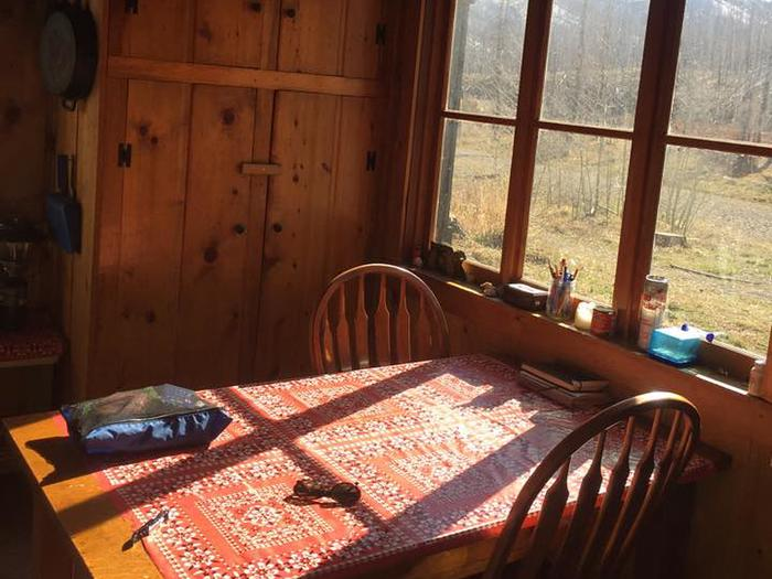 Dining table with view outside windowWest Fork Cabin Dining Area