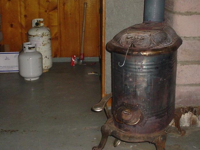 Wood stove with axe in backgroundWest Fork Cabin wood stove