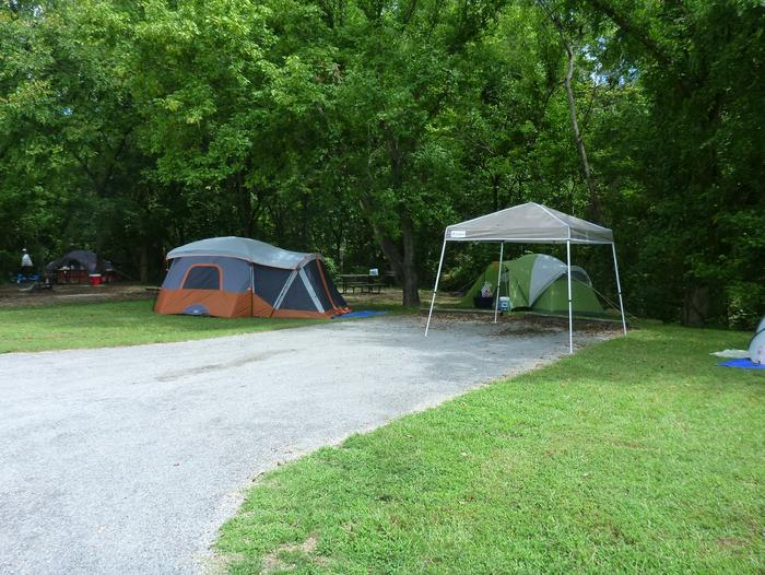 Tyler Bend Main Loop SiteSite #4, 40' back-in, no tent pad.  Parking area is wide enough to park RV & car side by side.