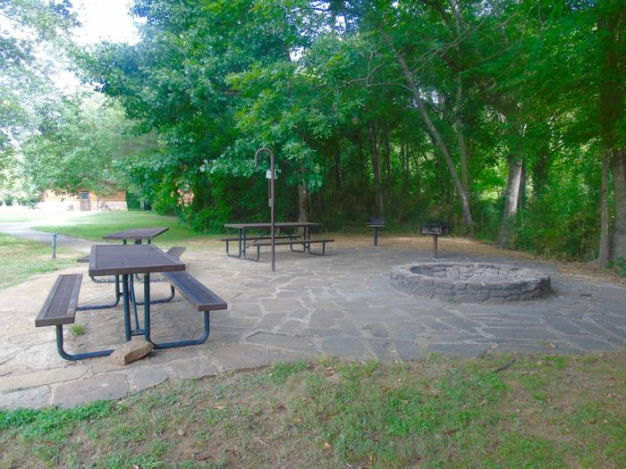 Tyler Bend Group Site 4Group Site #4: Three picnic tables; one lantern holder; two charcoal cooking stands; one large fire pit.