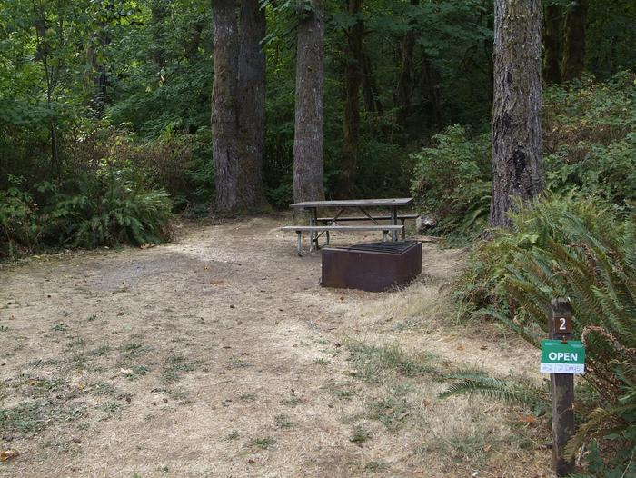 Camp site 2: Small site, table, fire ring, and tent pad provided. Parking is adjacent to site.
