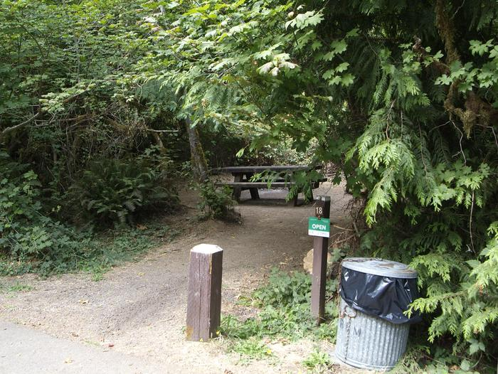 Camp site 18: fully enclosed private site with table, fire ring, and tent pad. Parking is parallel to site and road. Camp site 18: fully enclosed private site with table, fire ring, and tent pad. Parking is parallel to site and campground road.