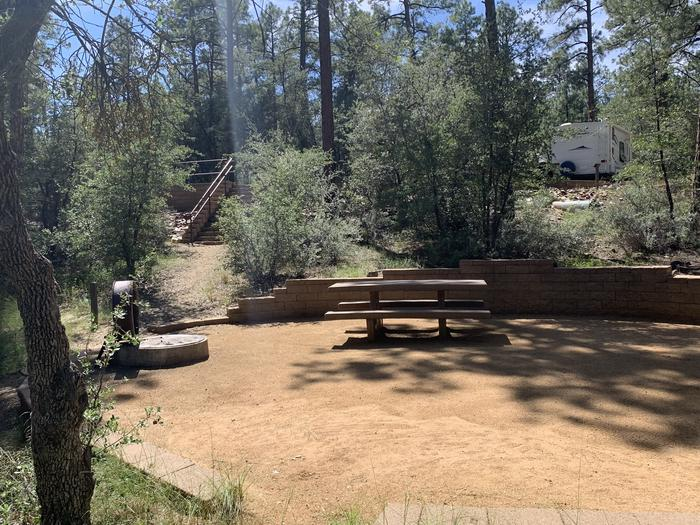 A photo of Site 32 of Loop H at LYNX CAMPGROUND with Picnic Table, Fire Pit, and a dozen stairs to climb up to parking.