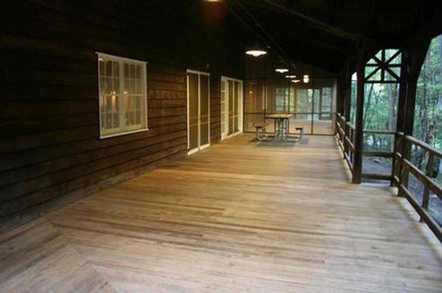 Front Porch of Appalachian Club HousePorch with picnic table and screened in area of facility