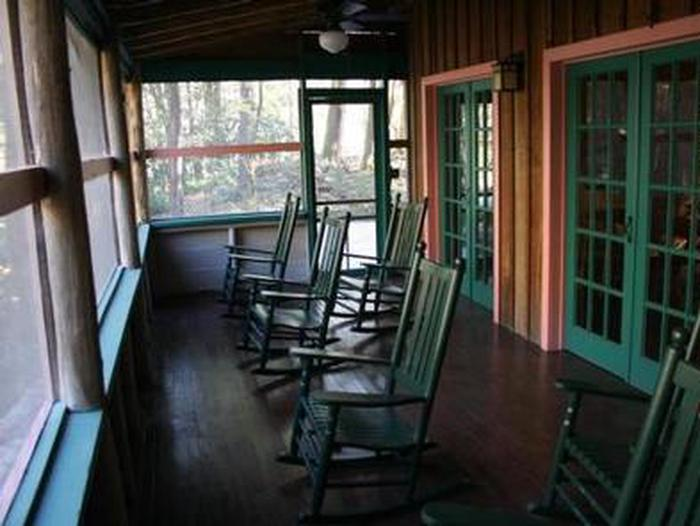 Screened porch area of Spence CabinScreened porch with rocking chairs on river side of cabin