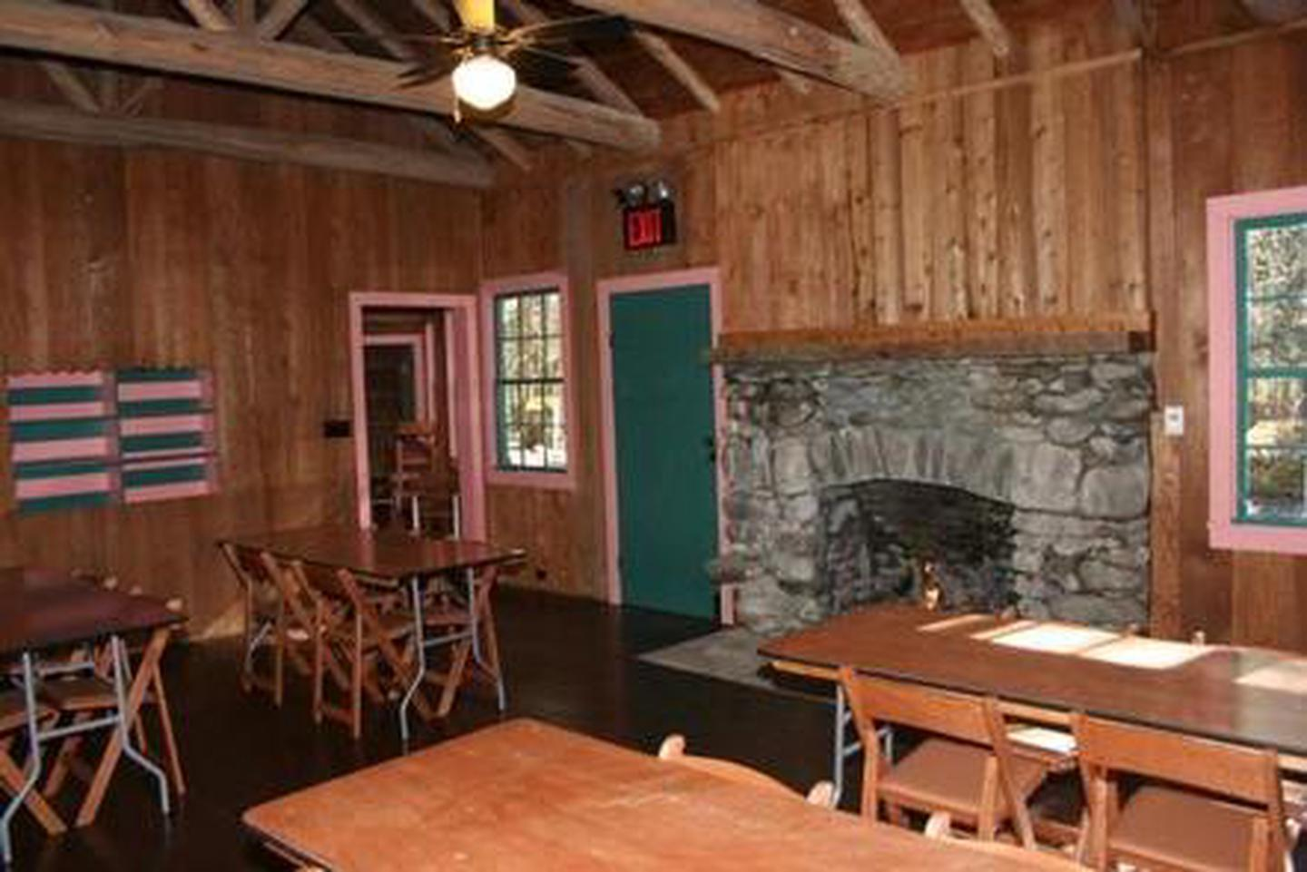 Main Room of Spence CabinMain Room showing tables and chairs and gas fireplace