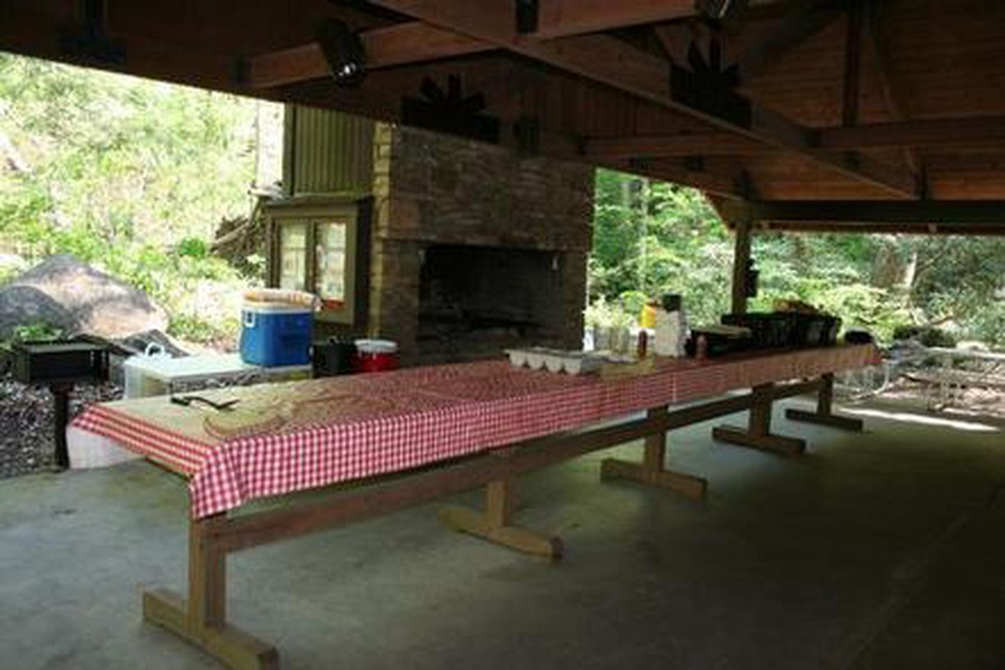 Twin Creek Picnic Pavilion Banquet table and fireplace grill