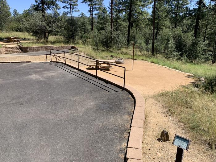 A photo of Site 16 of Loop D at LYNX CAMPGROUND with Picnic Table, Fire Pit, Lantern Pole. Full view of on-street parallel parking.