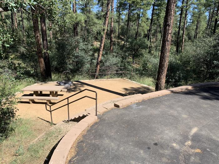 A photo of Site 14 of Loop C at LYNX CAMPGROUND with Picnic Table, Fire Pit. Handrail for 8 steps with curbside on-street parking.