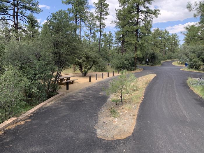 A photo of Site 01 of Loop A at LYNX CAMPGROUND with Picnic Table, Fire Pit. A photo of Site 01 of Loop A at LYNX CAMPGROUND with Picnic Table, Fire Pit and drive-through parking.