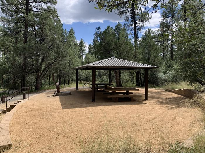 A photo of Site 19 of Loop D at LYNX CAMPGROUND with Picnic Table, Fire Pit, Shade