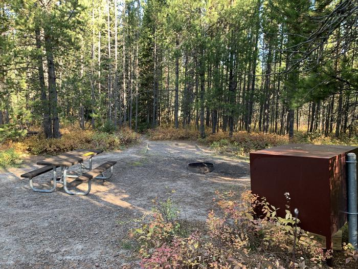A photo of Site 22 of Loop 1 at Signal Mountain Lodge Campground with Picnic Table, Electricity Hookup, Fire Pit, Shade, Food Storage, Tent Pad