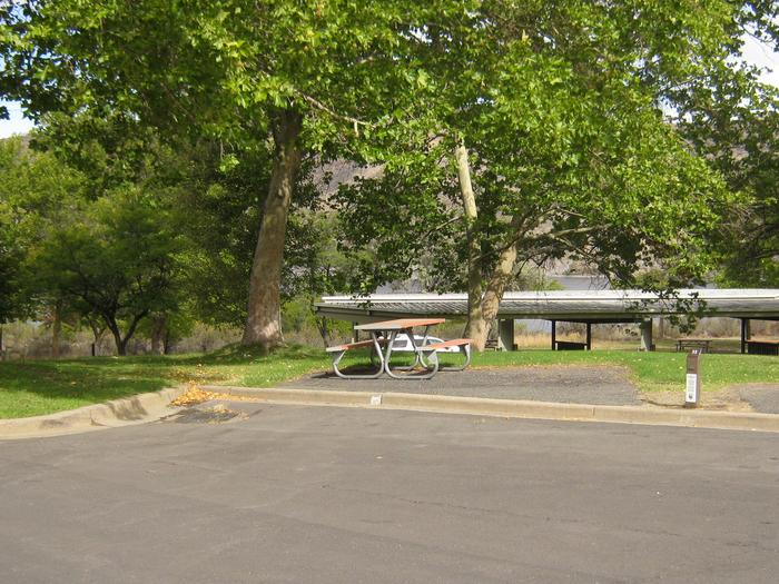 Back in paved parking. **No tents allowed on the watered grass.Site 33. **No tents allowed on the watered grass.