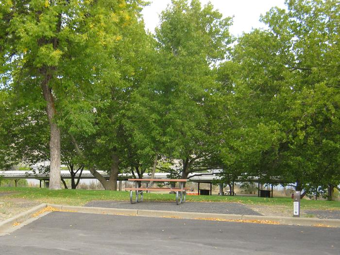 Back in paved parking. **No tents allowed on the watered grass.Site 39. **No tents allowed on the watered grass.