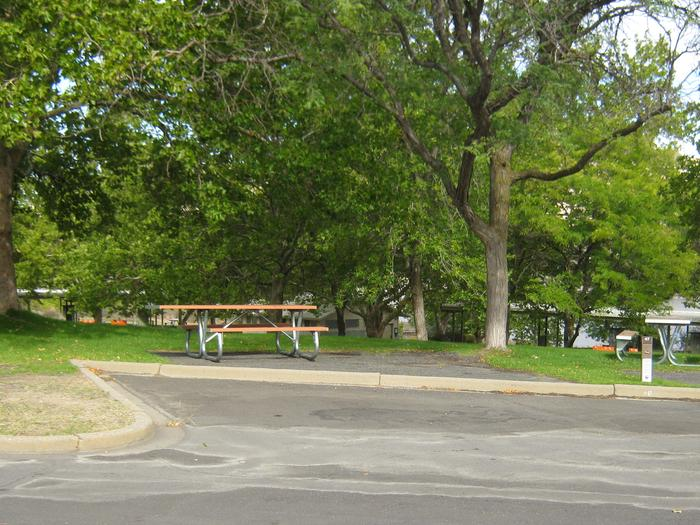 Back in paved parking. **No tents allowed on the watered grass.Site 47. **No tents allowed on the watered grass.