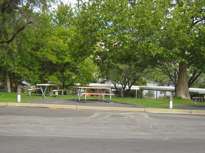 Back in paved parking. **No tents allowed on the watered grass.Site 49. **No tents allowed on the watered grass.