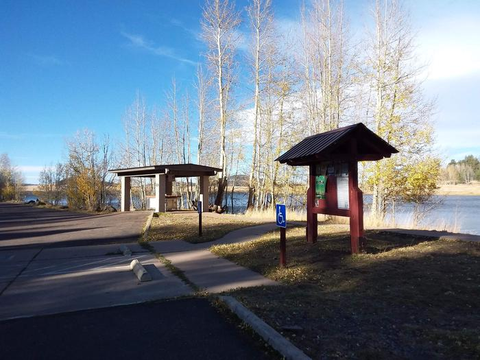 Grayling Campground Information Kiosk with view of Big Lake