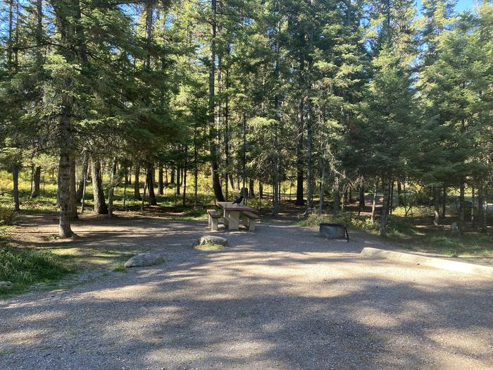 A photo of Site 031 of Loop C - BAY at HOLLAND LAKE CAMPGROUND with Picnic Table, Fire Pit