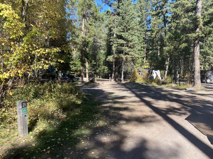 A photo of Site 029 of Loop C - BAY at HOLLAND LAKE CAMPGROUND with Picnic Table, Fire Pit