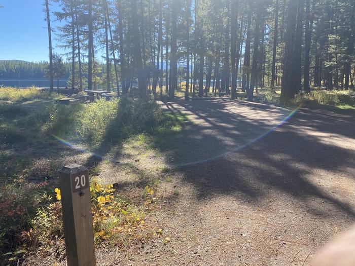 A photo of Site 020 of Loop C - BAY at HOLLAND LAKE CAMPGROUND with Picnic Table, Fire Pit