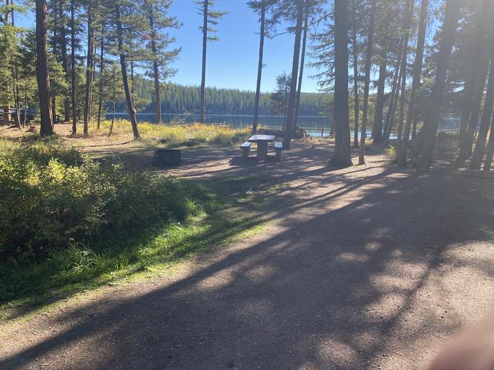 A photo of Site 020 of Loop C - BAY at HOLLAND LAKE CAMPGROUND with Picnic Table, Fire Pit, Waterfront