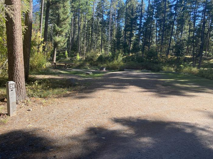 A photo of Site 024 of Loop C - BAY at HOLLAND LAKE CAMPGROUND with Picnic Table, Fire Pit