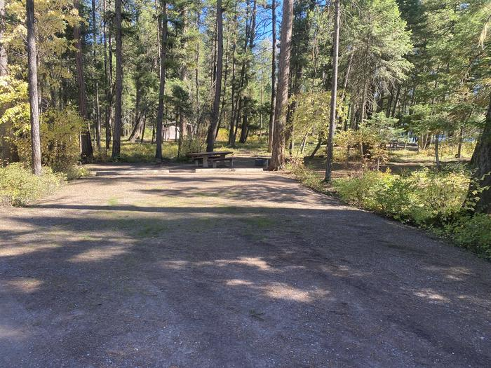 A photo of Site 028 of Loop C - BAY at HOLLAND LAKE CAMPGROUND with Picnic Table, Fire Pit